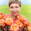Smile women with roses — Stock Photo