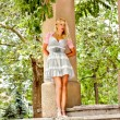 Beautiful blond woman in the park — Stock fotografie