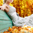 Women with autumn leafs — ストック写真