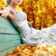Women with autumn leafs — Stock Photo
