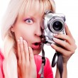 The surprised girl takes a picture - Stok fotoğraf