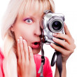 The surprised girl takes a picture - Stock Photo