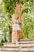 Beautiful blond woman in the park — Stock Photo