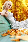 Women with autumn leafs — Stock fotografie