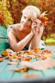 Women with autumn leafs — Stock Photo