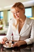 Blond women drinks tea — Stock Photo