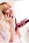 Woman talks by phone — Stock Photo