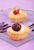 Fruit tarts with whipped cream — Stock Photo