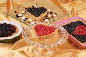 Assorted tarts with berries — Stock Photo