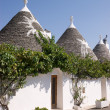 Trulli houses in Alberobello (Apulia) - Stock Photo