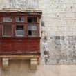 Balconies and windows in Malta, an ancient city — Stock Photo
