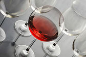 Redwine glass on steel background — Stock Photo