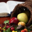 Stock Photo: Cornucopia and the Bible