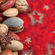 Nuts on Christmas background - Stock Photo