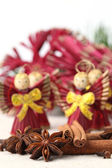 Spices with straw Christmas angels — Stock Photo