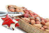 Christmas basket with nuts and nutcracker — Stock Photo