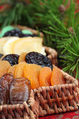 Christmas tree basket with dried fruits — Photo