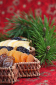 Christmas tree basket with dried fruits — Stock Photo
