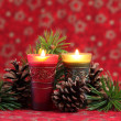 Christmas arrangement with candles and cones — Stock Photo