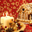 Christmas decoration with candles and gingerbread house — Photo