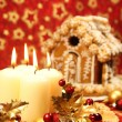 Christmas decoration with candles and gingerbread house — Stock Photo #7424062