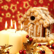 Stock Photo: Christmas decoration with candles and gingerbread house