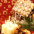 Christmas decoration with candles and gingerbread house — Stock Photo #7424066