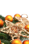 Arrangement with orange Christmas ornaments and gold stars — Photo