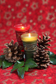 Christmas arrangement with candles and cones — Stok fotoğraf