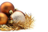 Gold and brown Christmas ornaments — Stock Photo