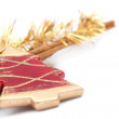 Red Christmas tree ornament and cinnamon sticks — Stock Photo