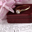 Stock Photo: Bible and engagement ring