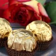 Chocolate and rose — Stock Photo