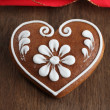 Gingerbread heart and red ribbon — Stock Photo