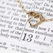 Gold necklace with heart on the Bible — Foto Stock