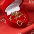 Golden necklace with heart — Stock Photo #7436874