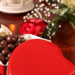 Heart shaped box with chocolate, rose and lantern - Stockfoto