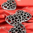 Heart shaped silver ornaments — Stock Photo #7437116
