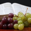 Grapes and the Bible - Stock Photo