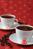 Coffee with hearts and coffee-beans — Stock Photo