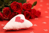 Embroidered heart and roses — Stock Photo