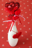 Heart decorations in a vase — Stock Photo