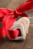 Red ribbon with shortbread hearts — Stock Photo