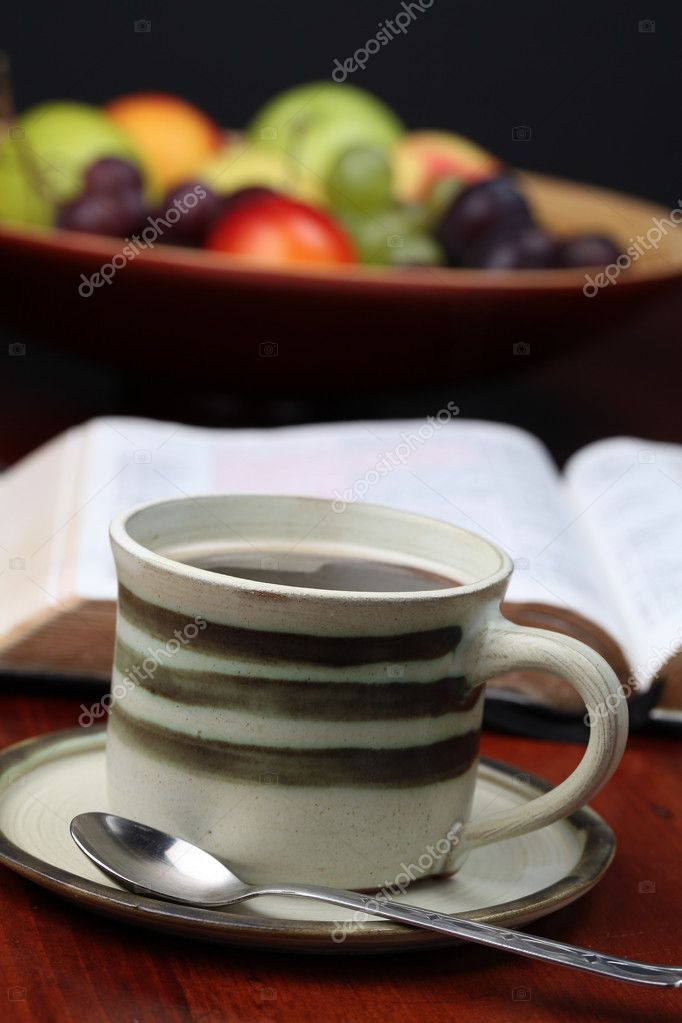 Morning coffee with the Bible and fruits in background. Shallow dof — Stock Photo #7437830