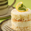 Coconut and lemon cake with coffee — Stock Photo #7445878