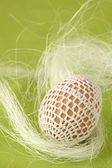 Easter egg with white crochet decoration — Foto Stock