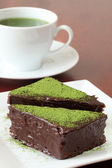 Chocolate cake with green tea powder — Stock Photo
