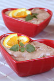 Chocolate mousse hearts with oranges — Stock Photo