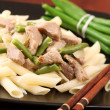 Penne rigate with pork and green beans - Stock Photo