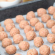 Raw meatballs on baking sheet — Stock Photo
